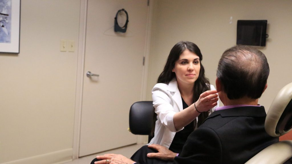 Photo of PA Stephanie Kaiser examining a patient at Dermatology & Laser Center of San Antonio