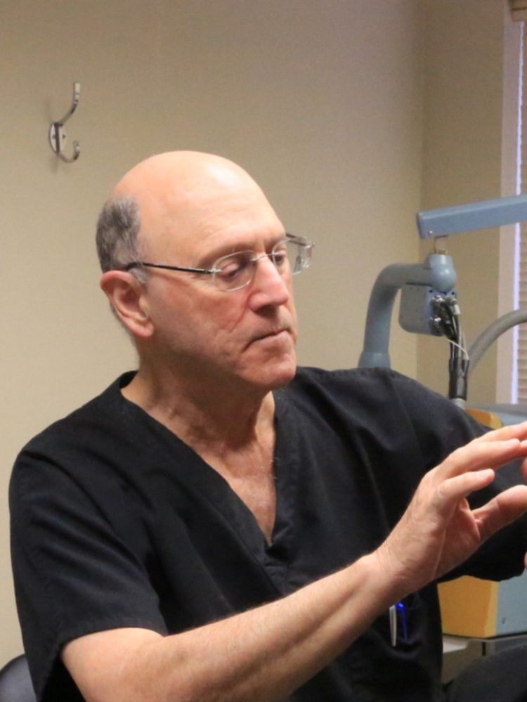 Dr. Davis examines a patient at Dermatology and Laser Center of San Antonio